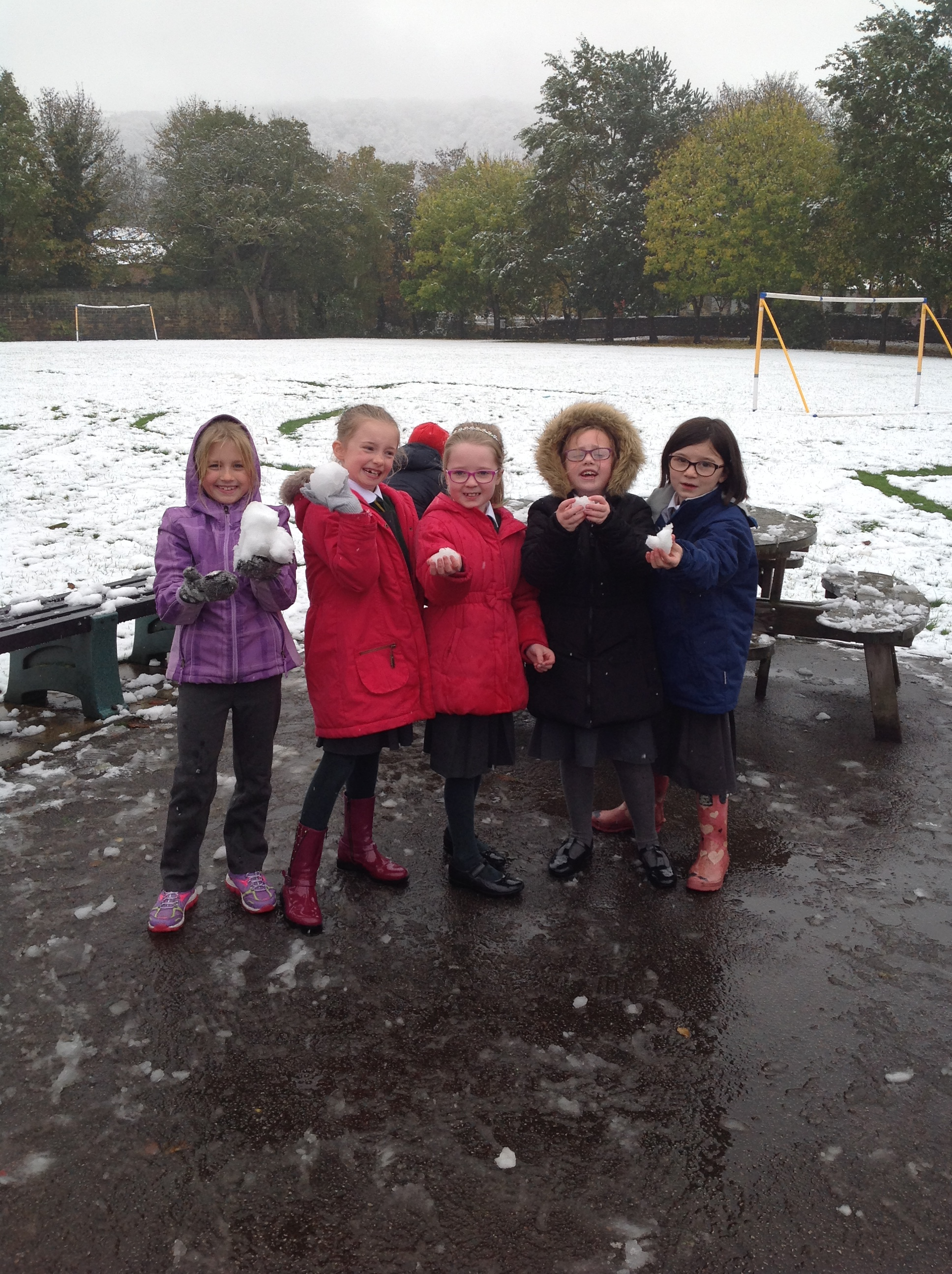 Some of the girls in the snow.