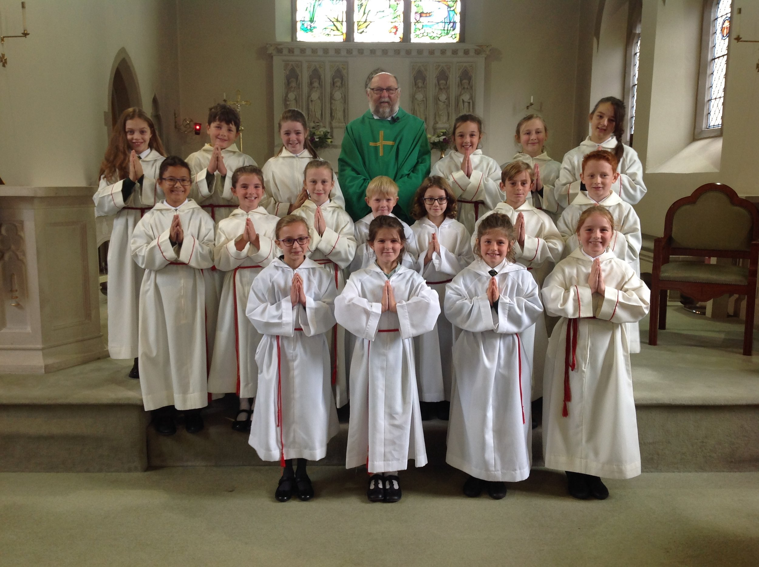 Our wonderful Year 5 and 6 altar servers with Father Lawrie.