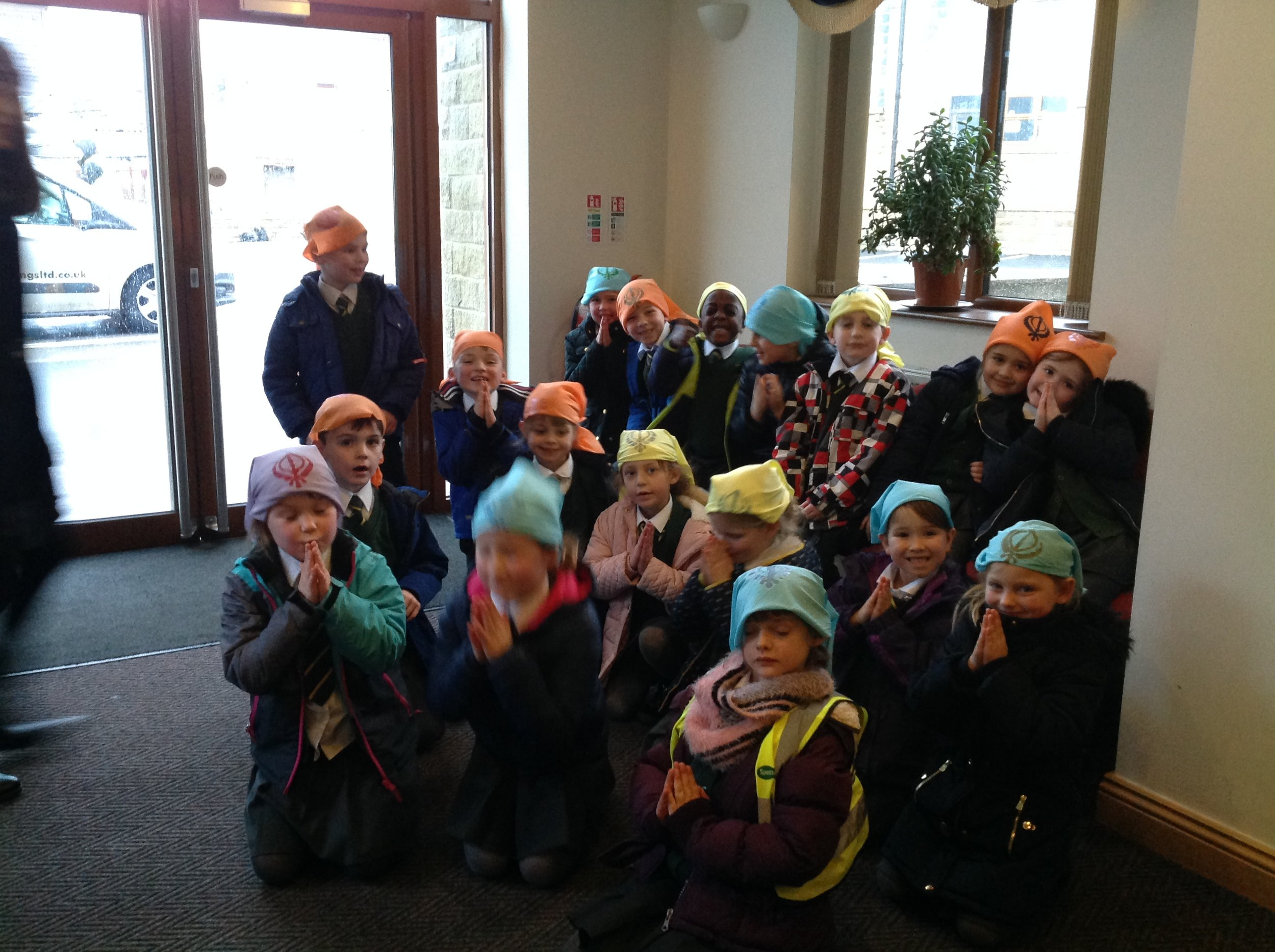 We covered our heads and took of our shoes. Mr Singh loved the scarves we had made at school.