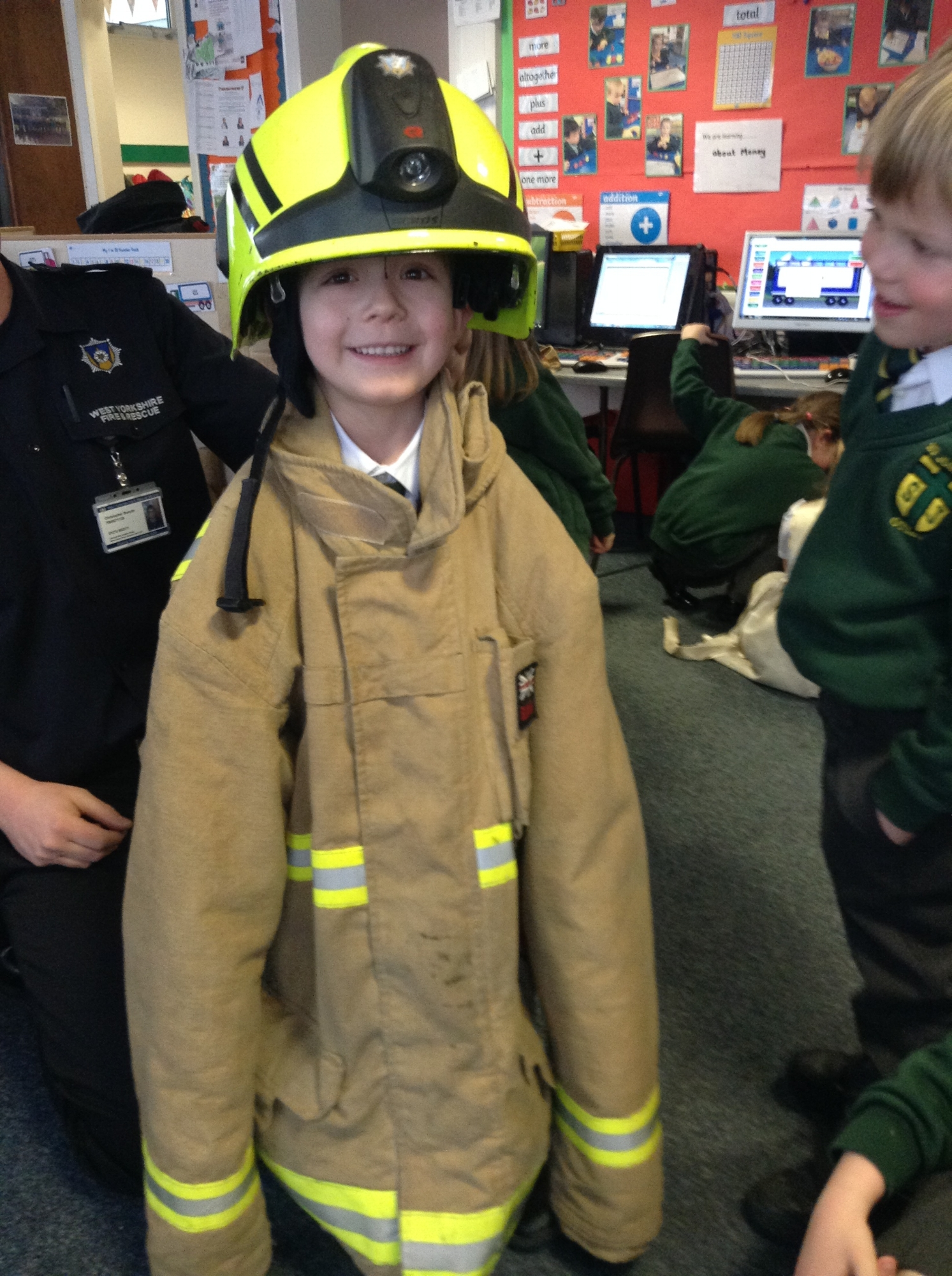 We enjoyed trying on the fire clothes.