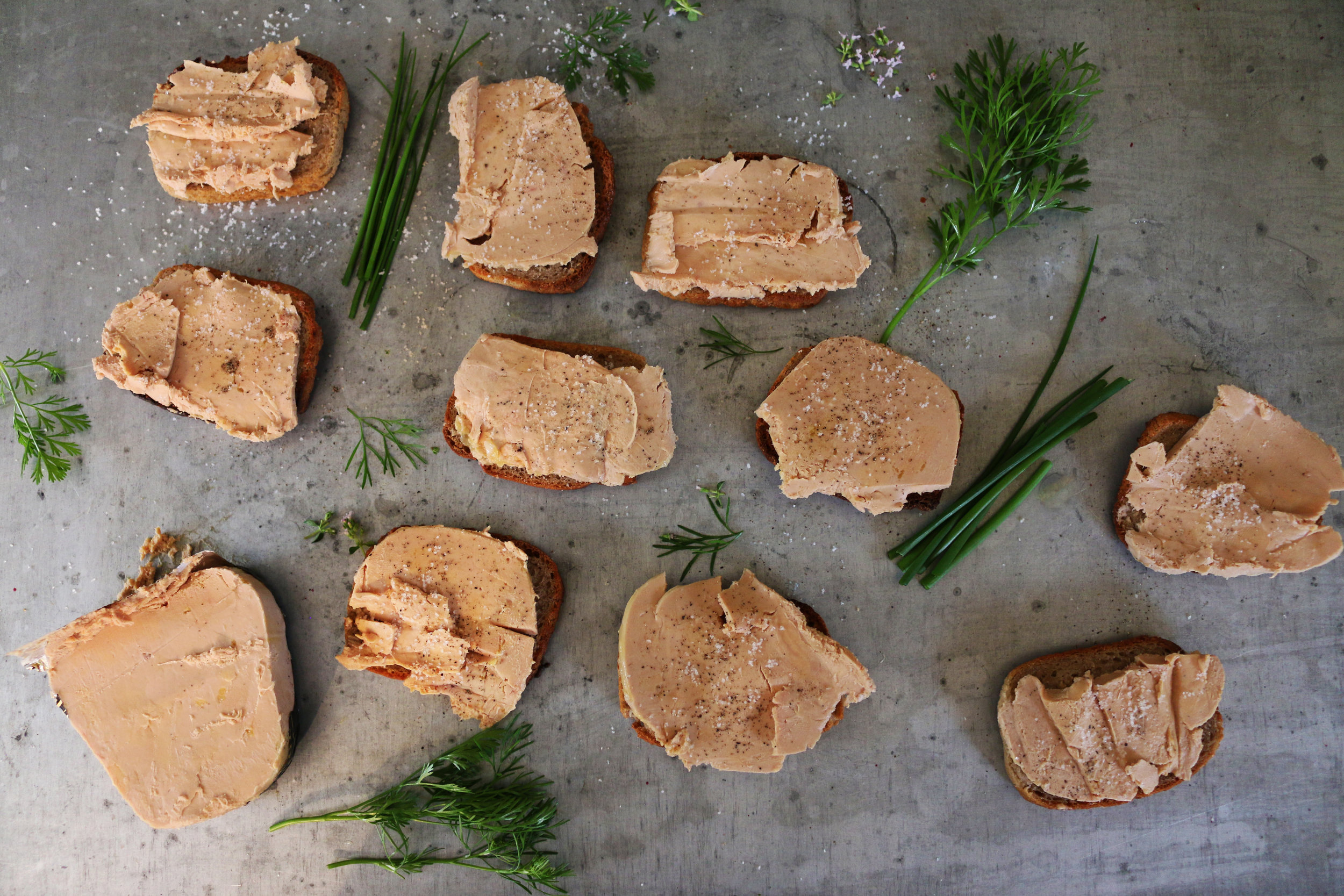 Foie gras on gluten free toasts with cracked pepper and large sea salt crystals from guérande.
