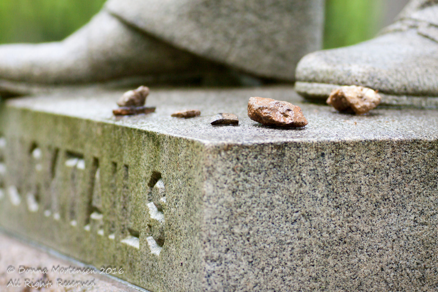 Echoes as memories: visitors have left rocks on the monument to the Bucktails