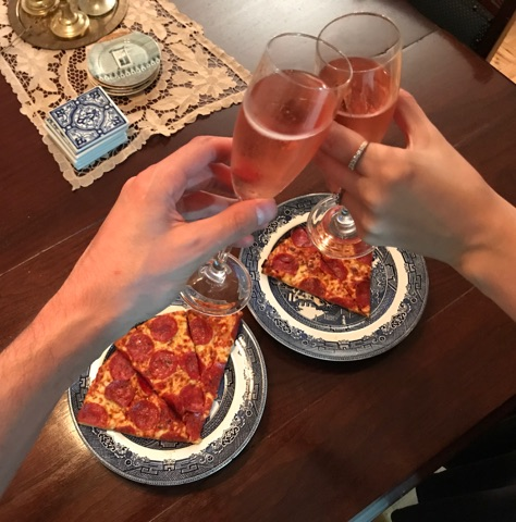 Celebrating with Pixie and pizza after getting engaged.
