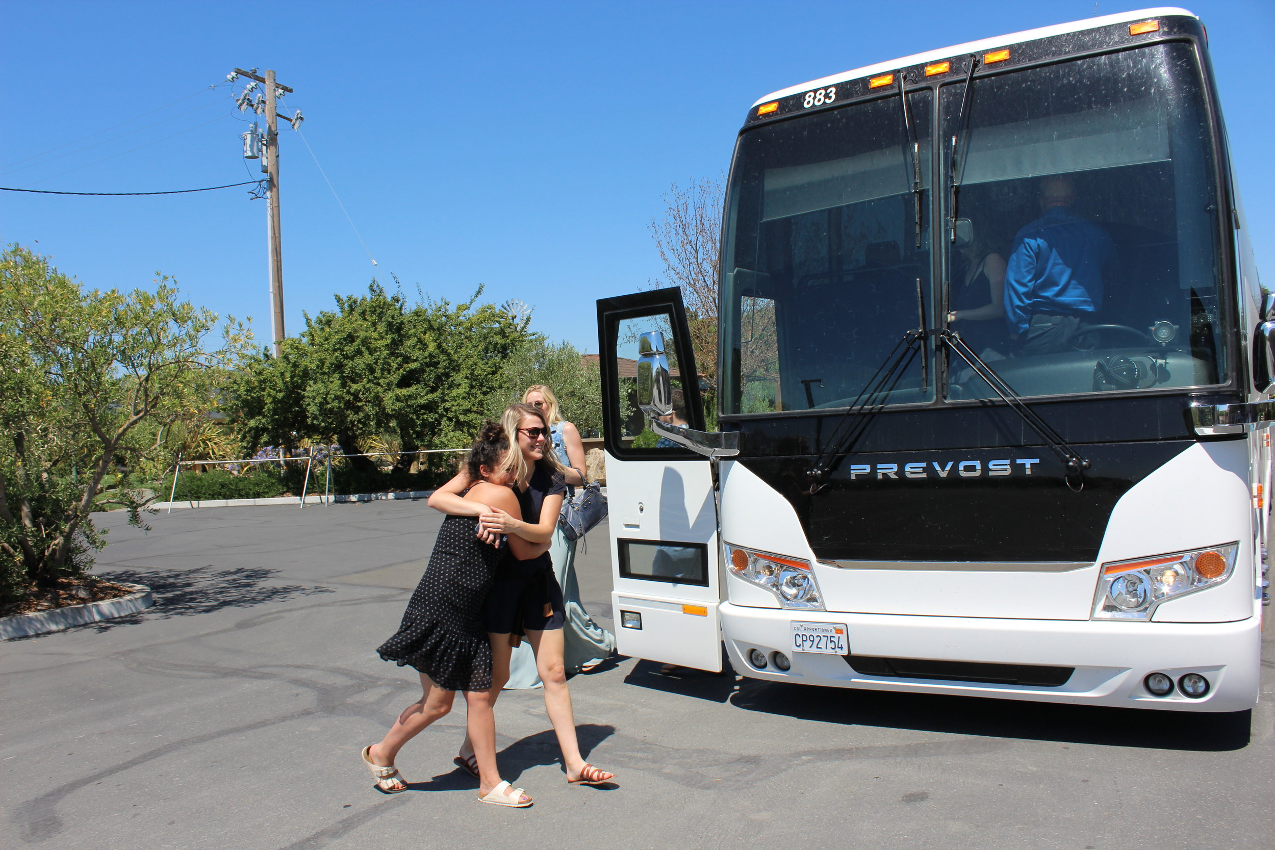 happy-tour-guests-in-front-of-luxury-coach-bus