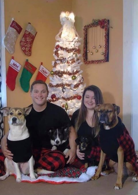 Felicia Woodall, Ryan Pence, and their dogs. Picture courtesy Amy Sanderson