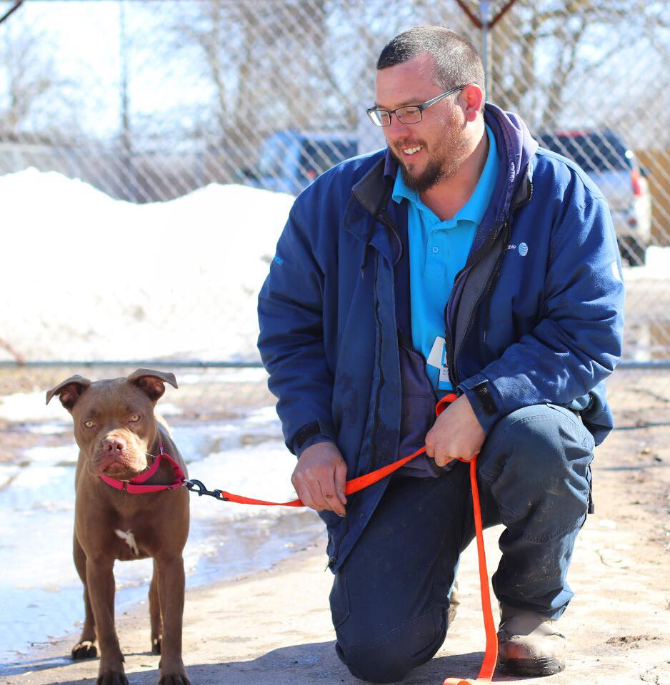 Blue with her new dad, Credit: Humane Society of Midland County