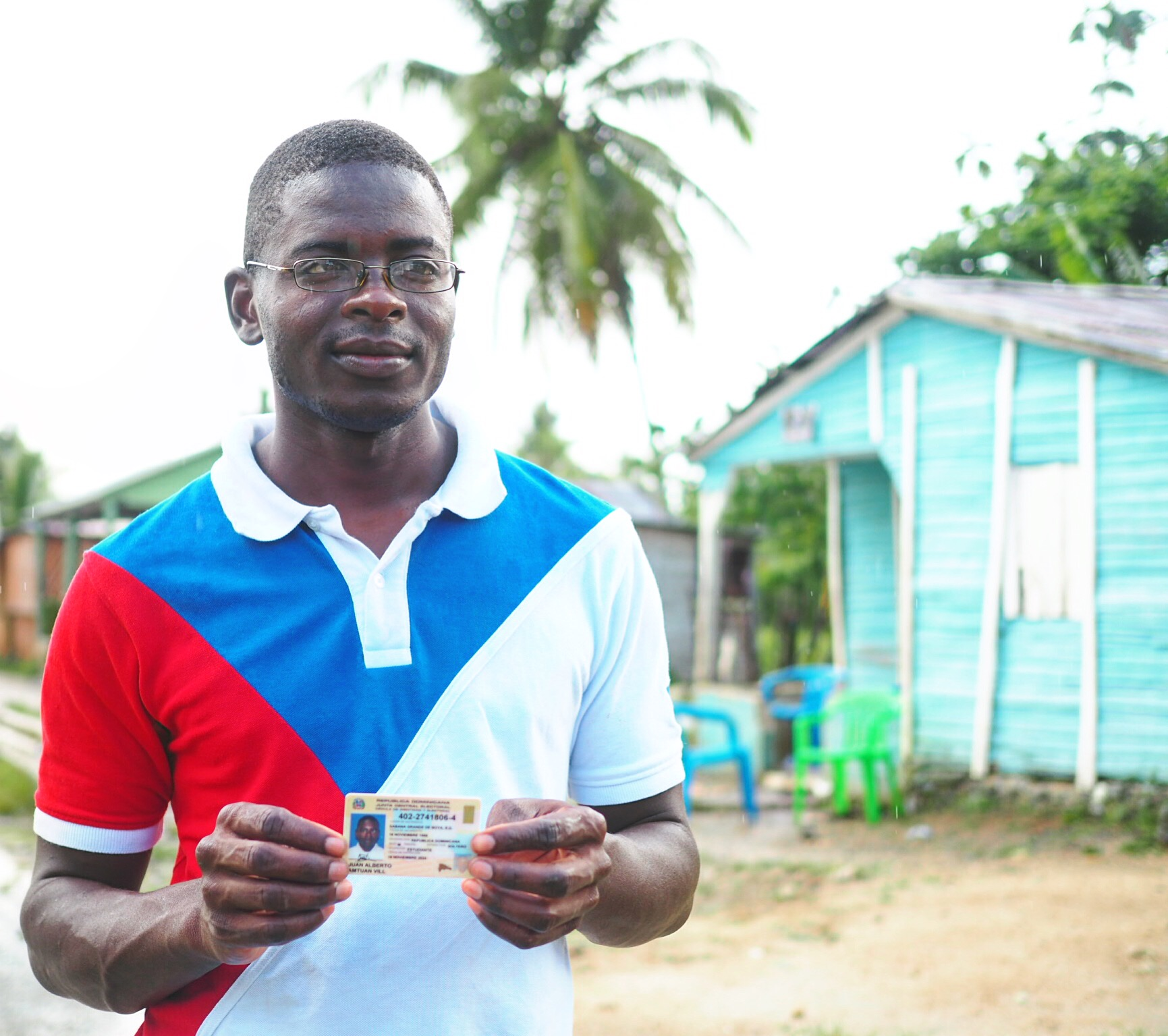 Juan-Alberto, local teacher and human rights activist, proudly showing his Dominican citizenship