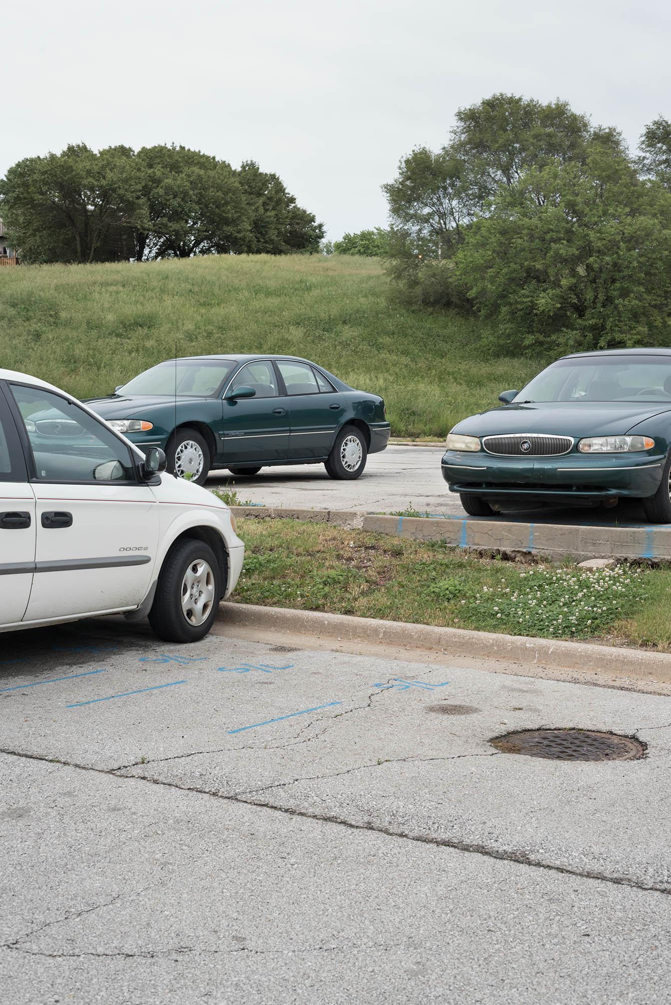 Two_cars_and_van_behind_honey_baked_ham.jpg