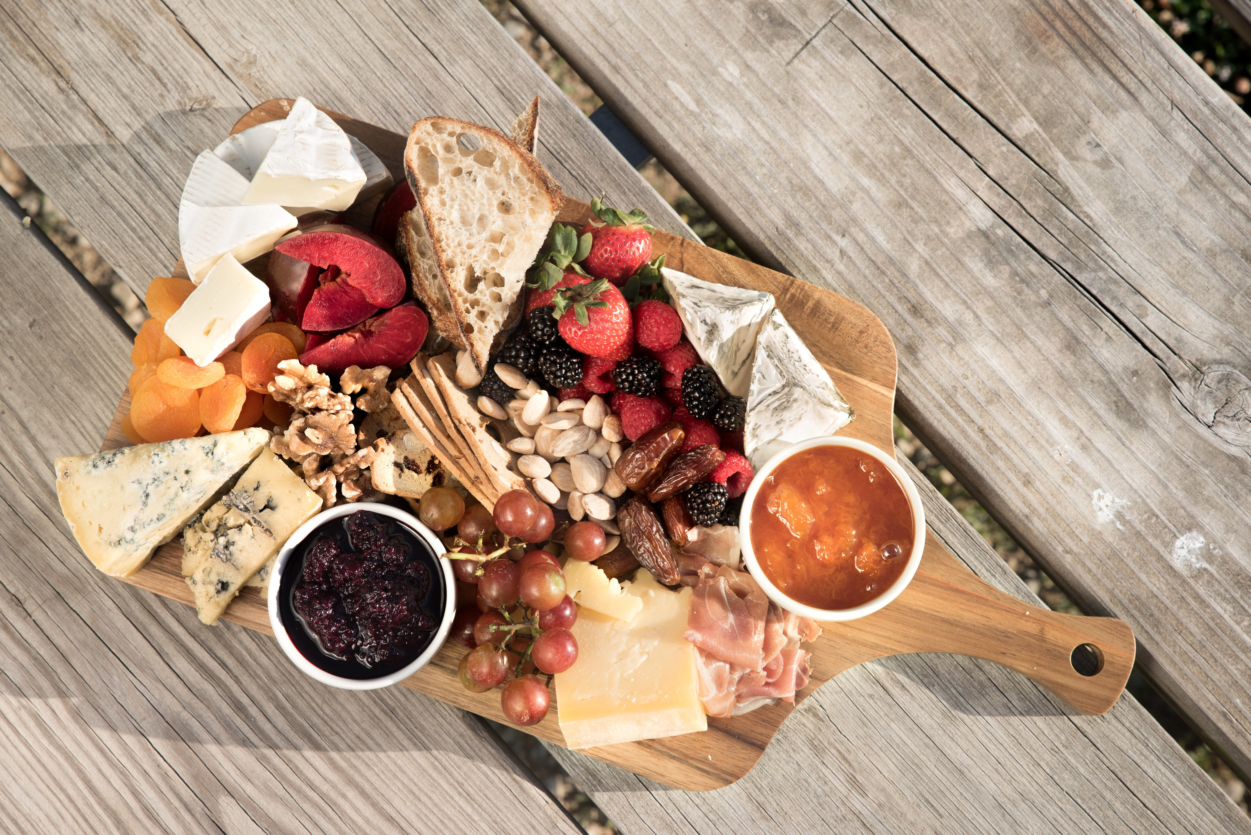 Charcuterie board handcrafted to highlight the fresh and local vendors that Ash and Bleu Cheese Co. worked with.