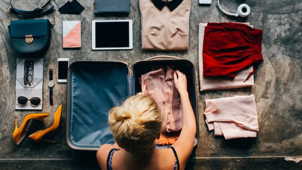girl-packing-her-suitcase.jpg
