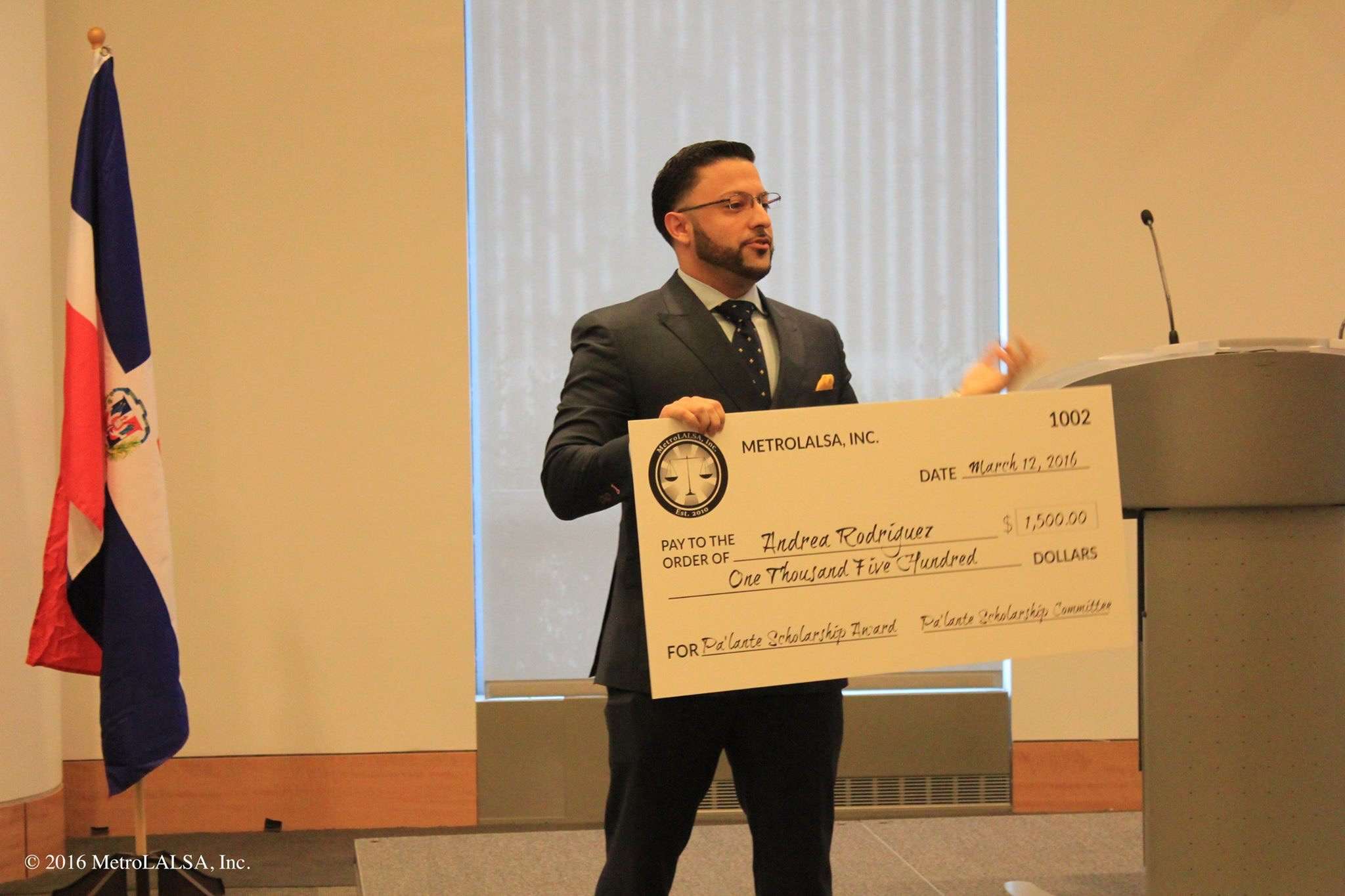 MetroLALSA Alumnus Christopher Carrion presenting the 2016 Pa'lante Scholarship Award at the Pa'lante VI Conference at Fordham University School of Law.