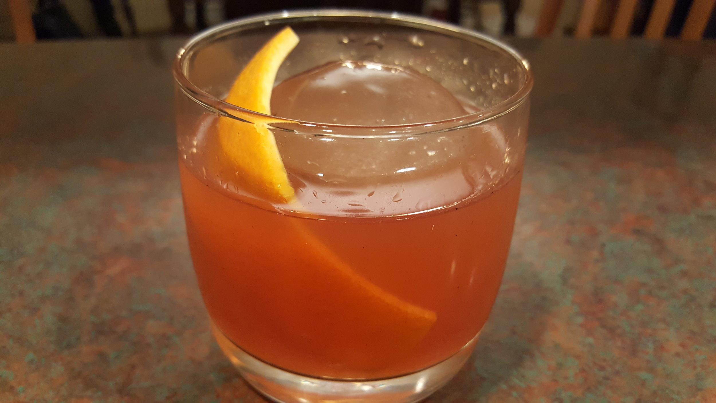 """Pictured is an  American  version of the Smoked Old Fashioned made with Rye Whiskey, details in """"Additional Thoughts"""" at the bottom of the page."""