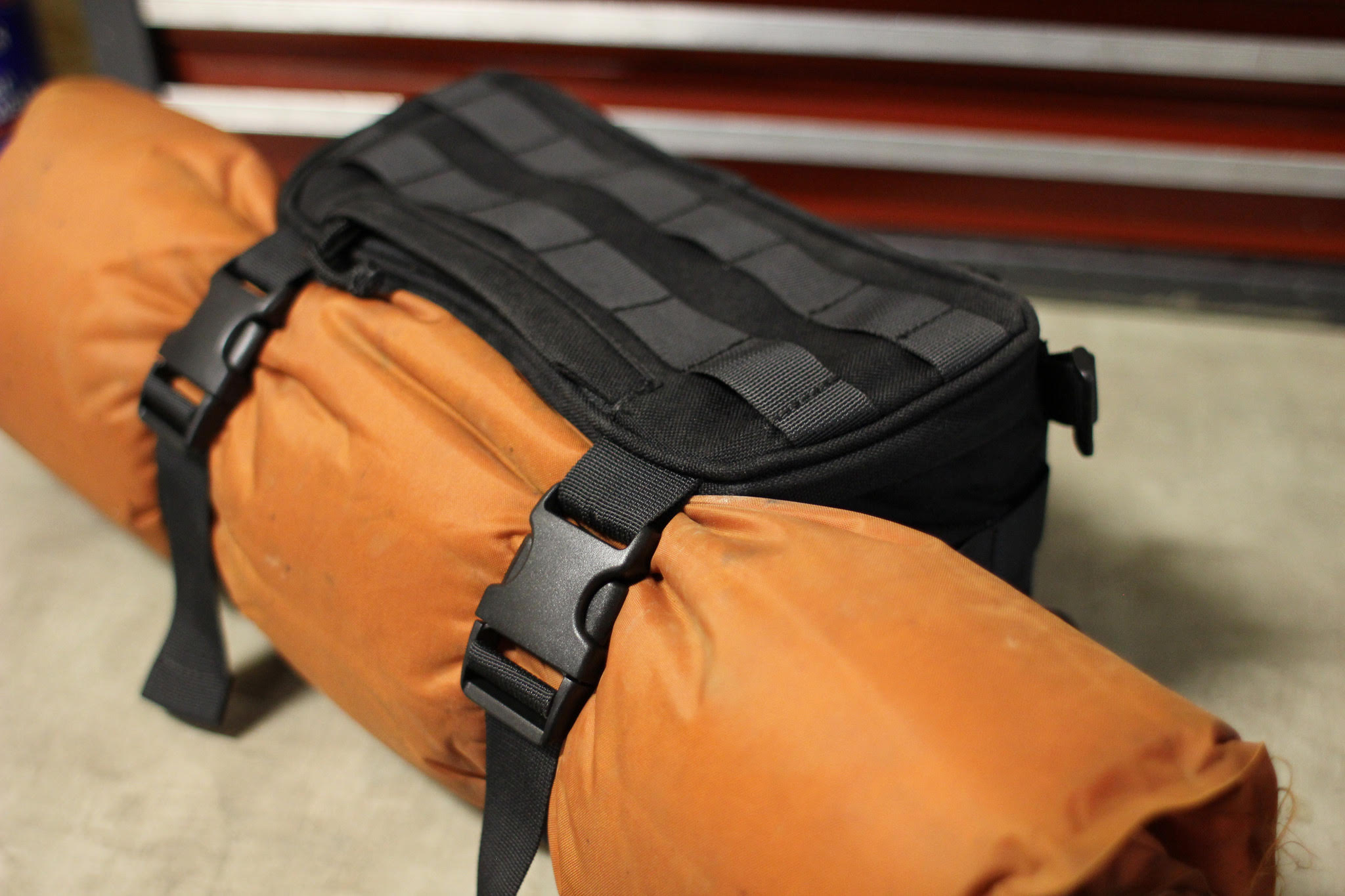 "Exfil­7: Shameless product plug. Straps on front are convenient for rolled up air mattress, layers of clothing or other junk. Bag holds tools and ""Ready"" gear (you can click this image to pick one up - Ashmore)"