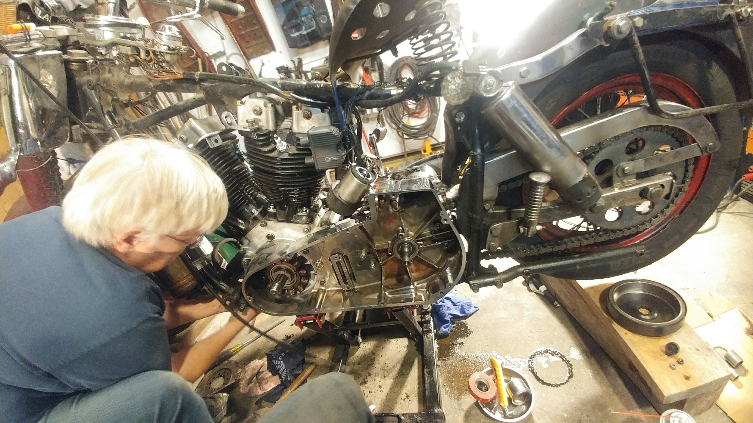 My mom, Terry, helping me out tightening up the engine mount bolts; Ma always says I should've been born a boy!