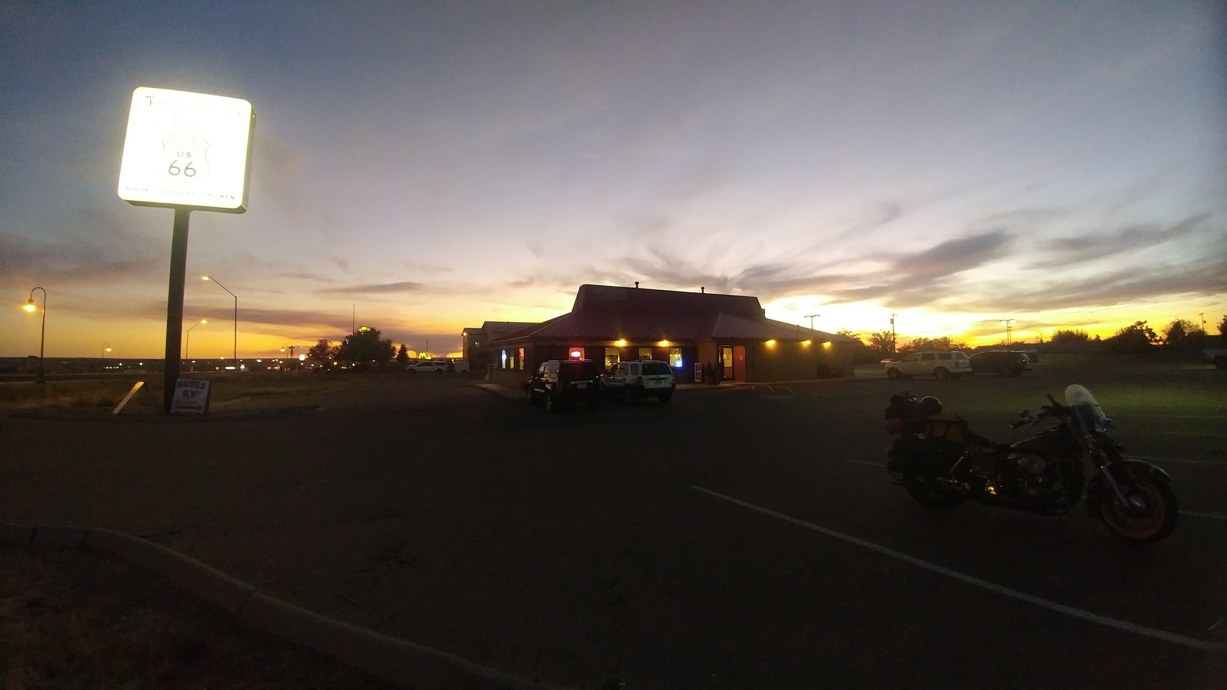 Holbrook Arizona and the Benchmark fire plume of smoke just to the left of the building on the horizon