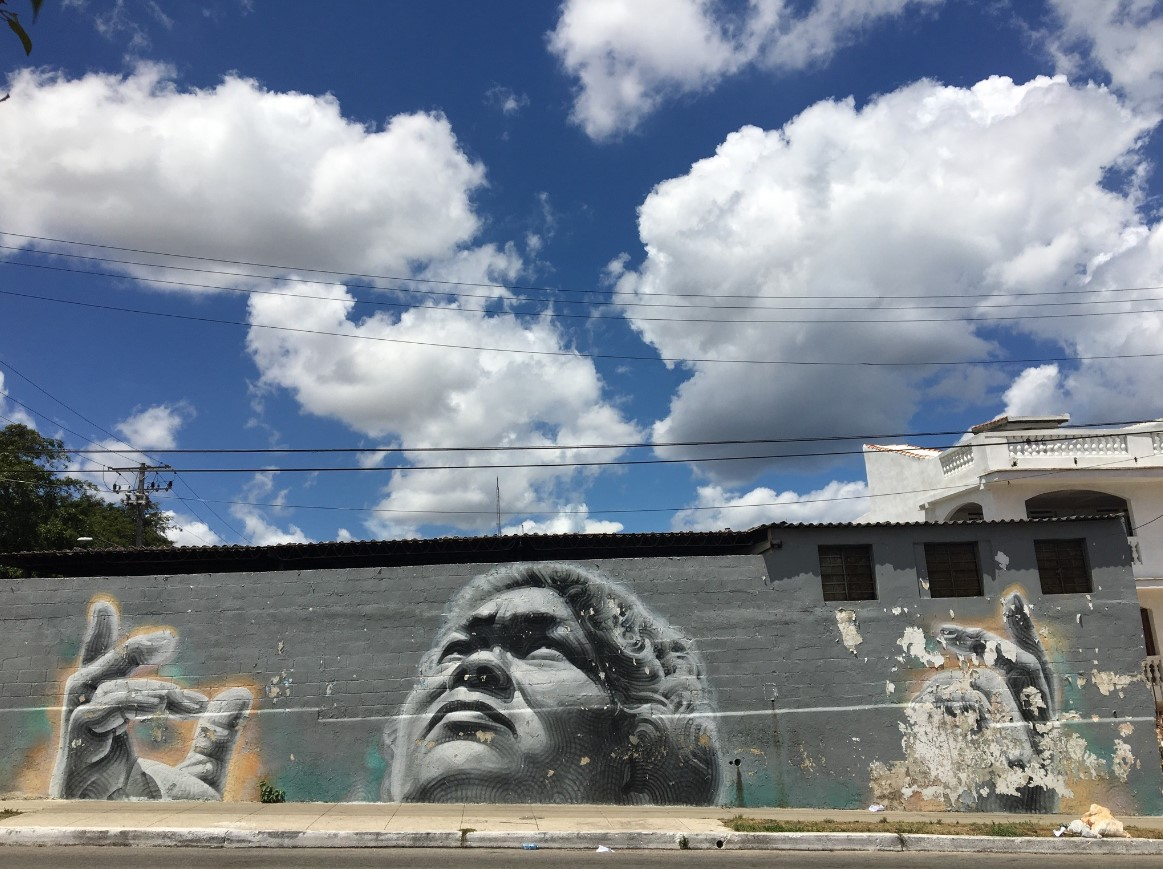 Also while walking around, we found mural created by El Mac.  Timing was everything since the clouds were aligned.