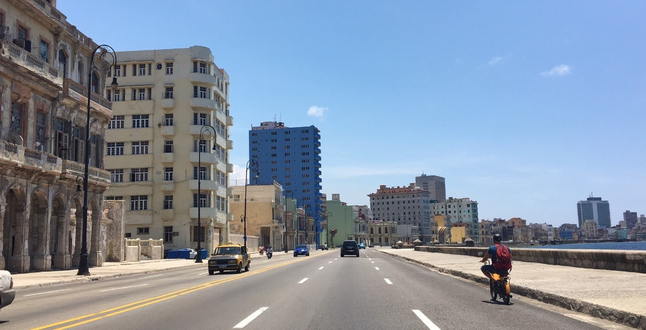 The Malecon is a broad roadway and seawall which stretches for 8 km along the coast in Havana. Here is a daytime view and below is while watching the sunset