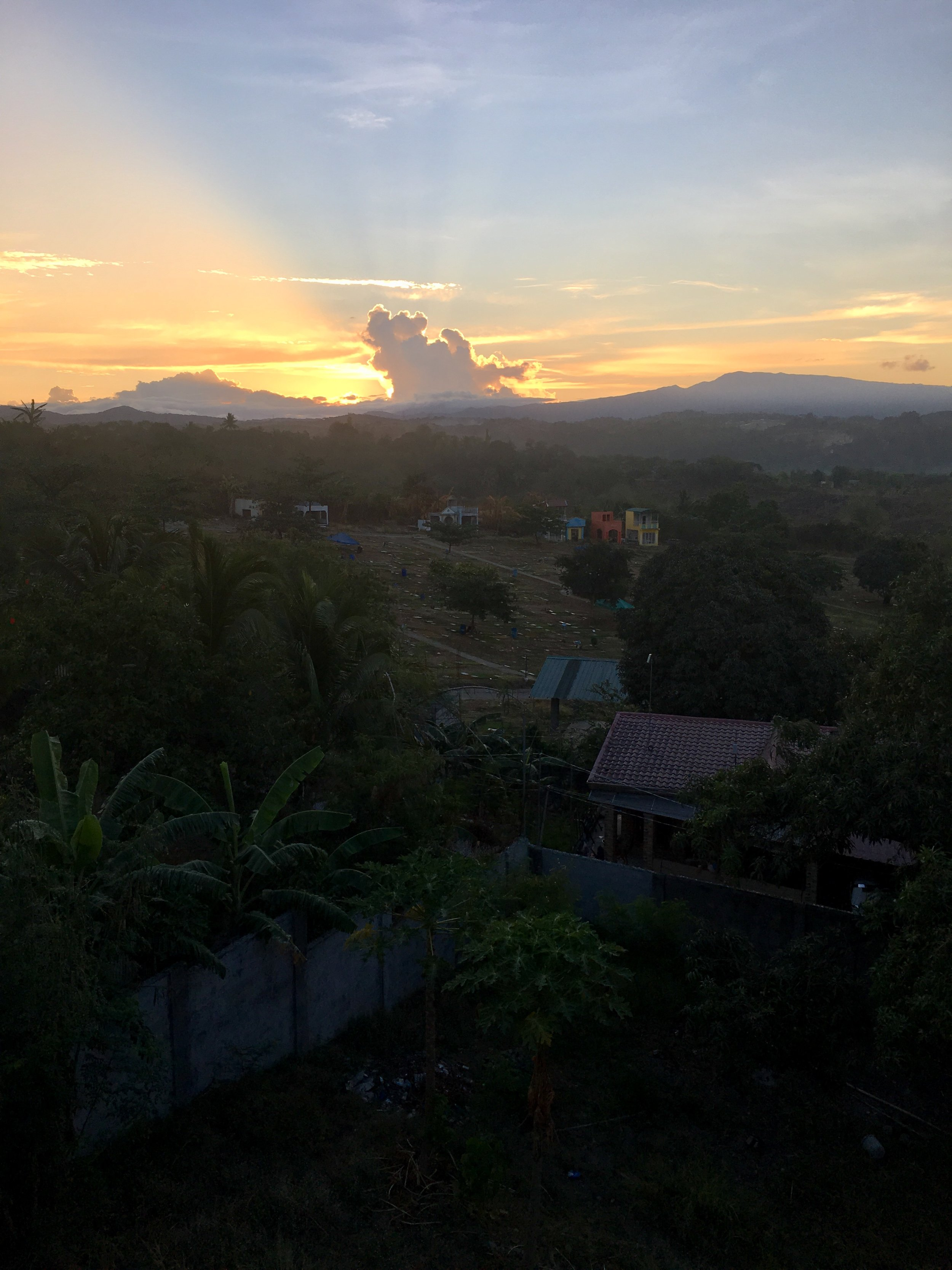 Sunrise accompanied by sounds of birds, roosters and engines starting for morning commute.