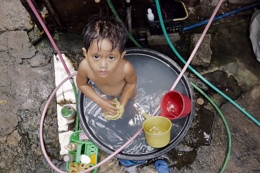 Tabo at batya, this is how Filipinos of all ages bathe.