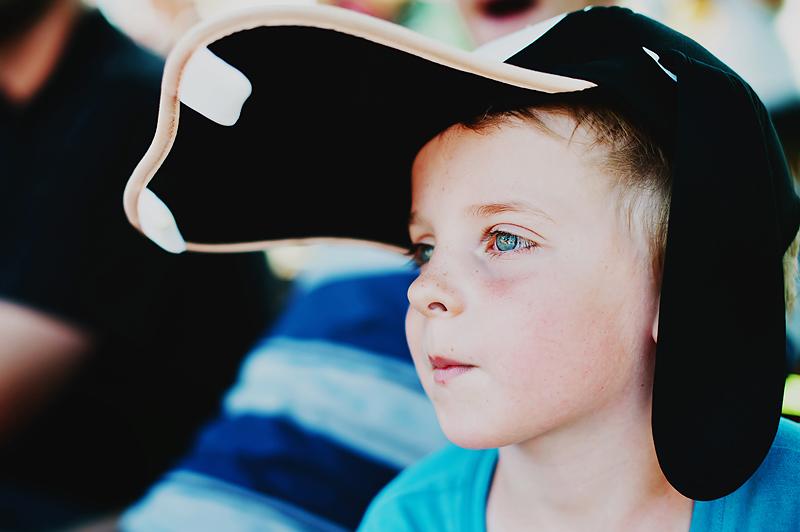 Boy at Disneyland wearing Goofy hat
