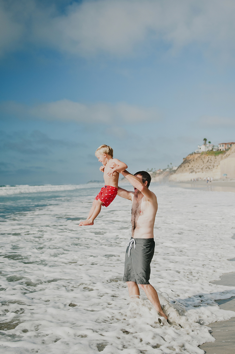 dad and son at beach in california