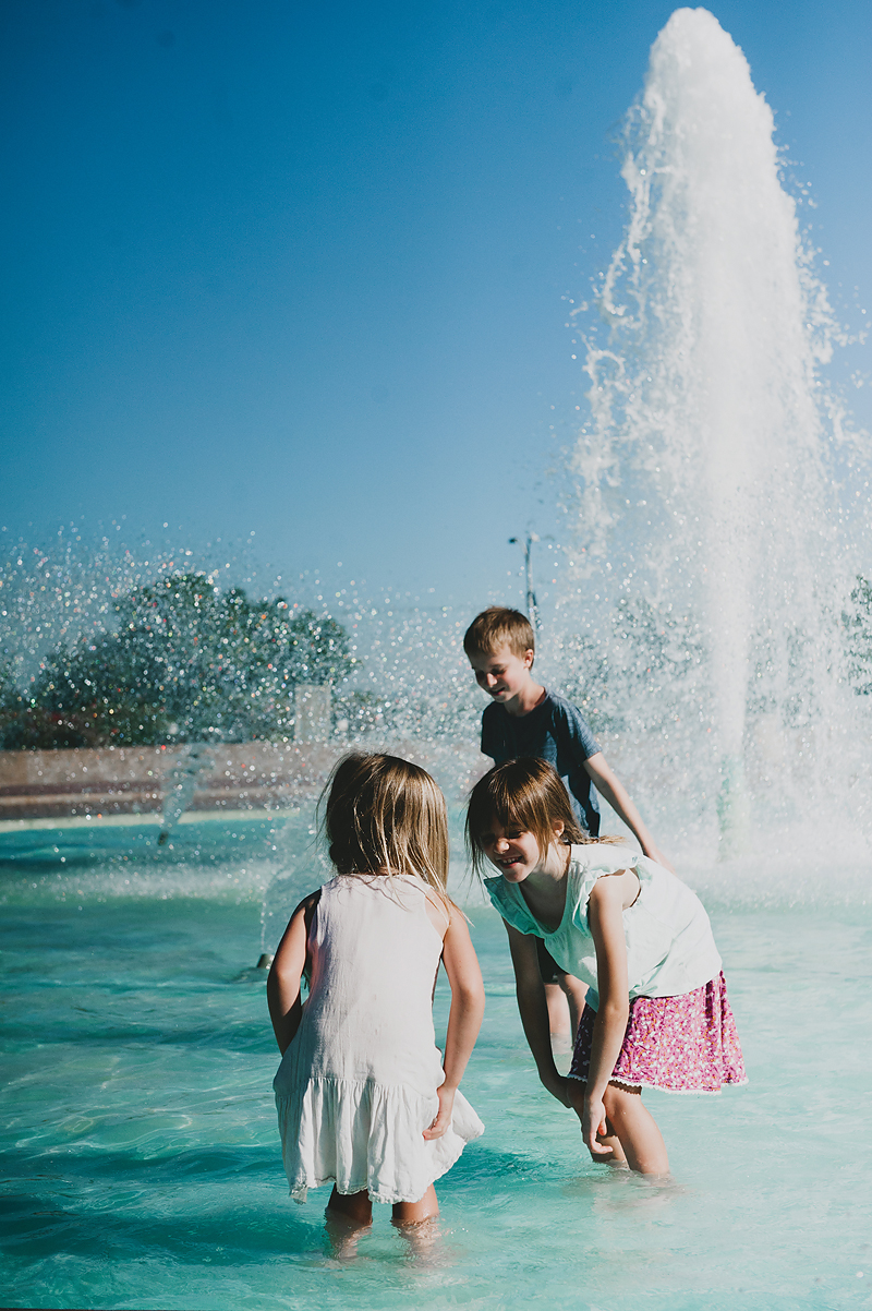girls and boy playing in fountain at balboa park
