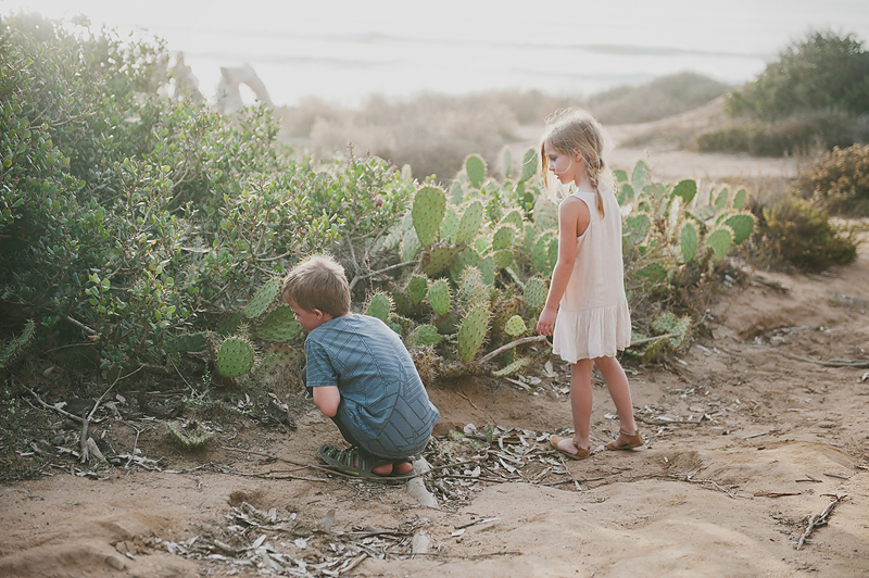 boy and girl in front of cactus cacti on California beach