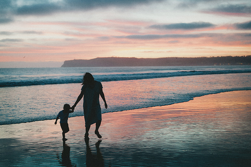 family photos on beach in california at sunset