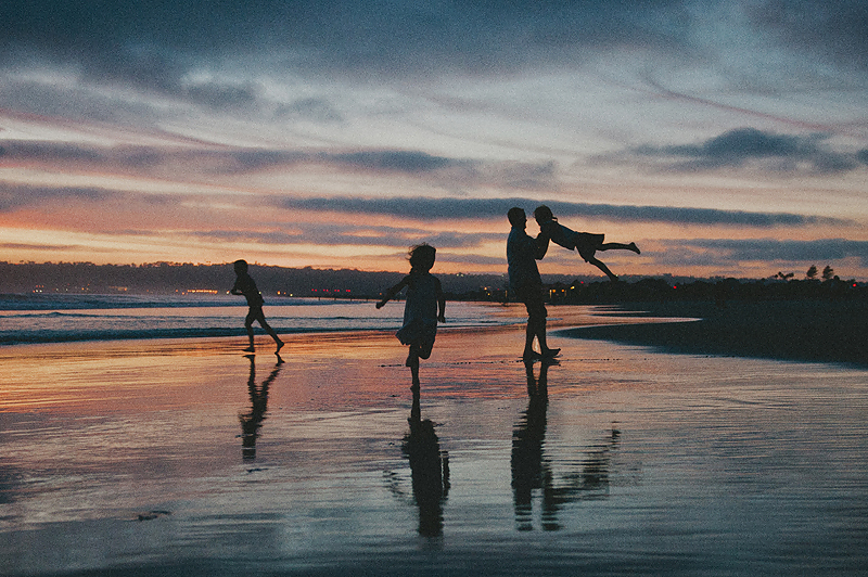 family pictures on beach in Southern California at sunset