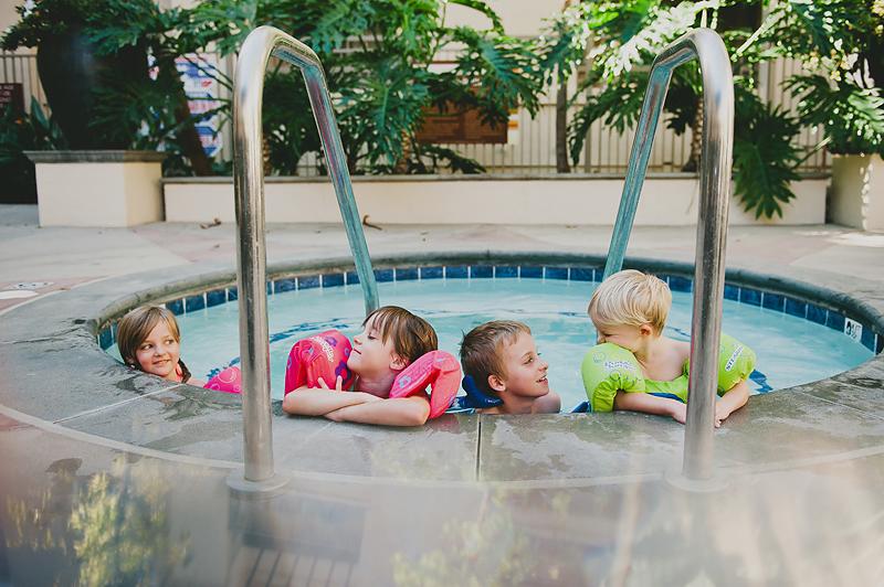 kids in hot tub wearing lifejackets