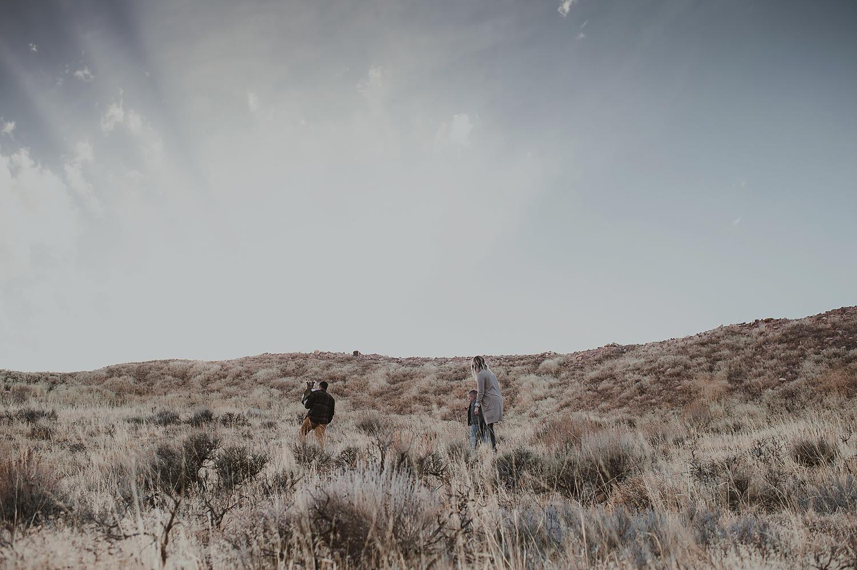Family walking on grassy hillside