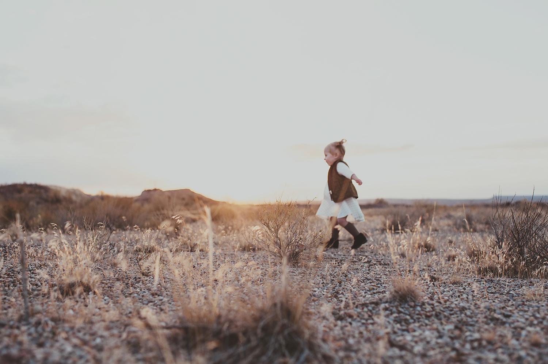 Toddler girl running around the outdoors