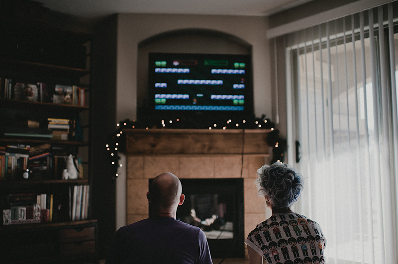 Couple playing video games together Super Mario World
