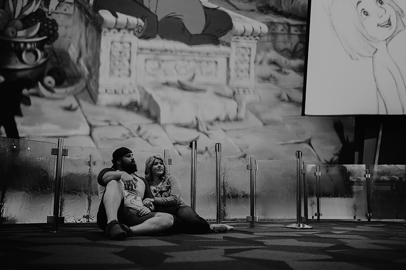 Couple sitting in animation building at disneyland california adventure park