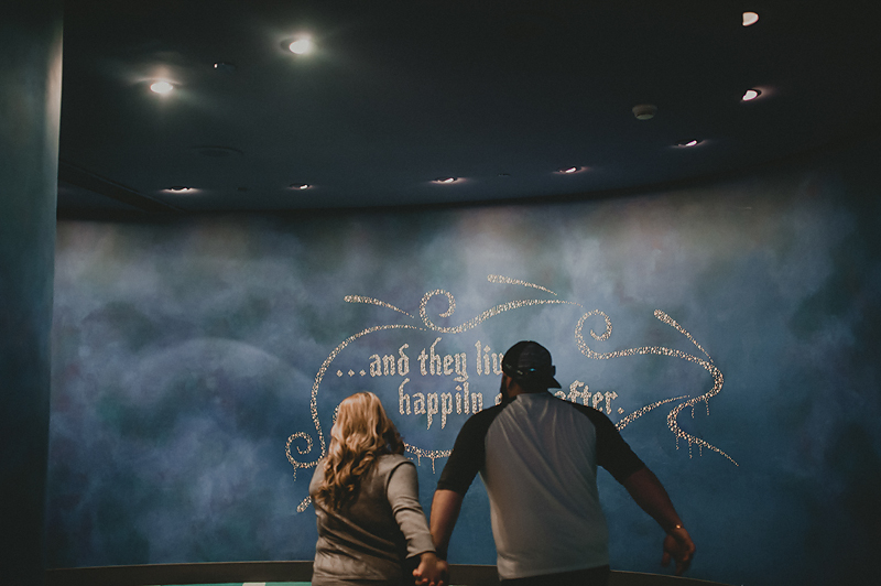 Couple running and playing in animation building at Disneyland california adventure park
