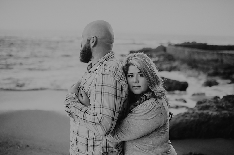 Couple leaning together on beach in California