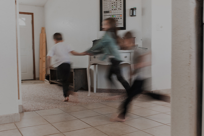 Kids running through house playing together