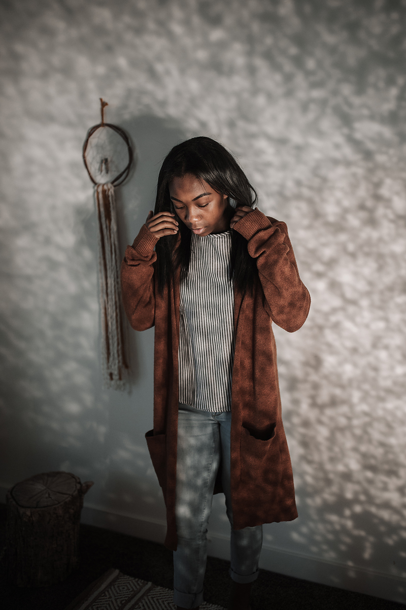 African American girl dancing light and shadow brown sweater dreamcatcher