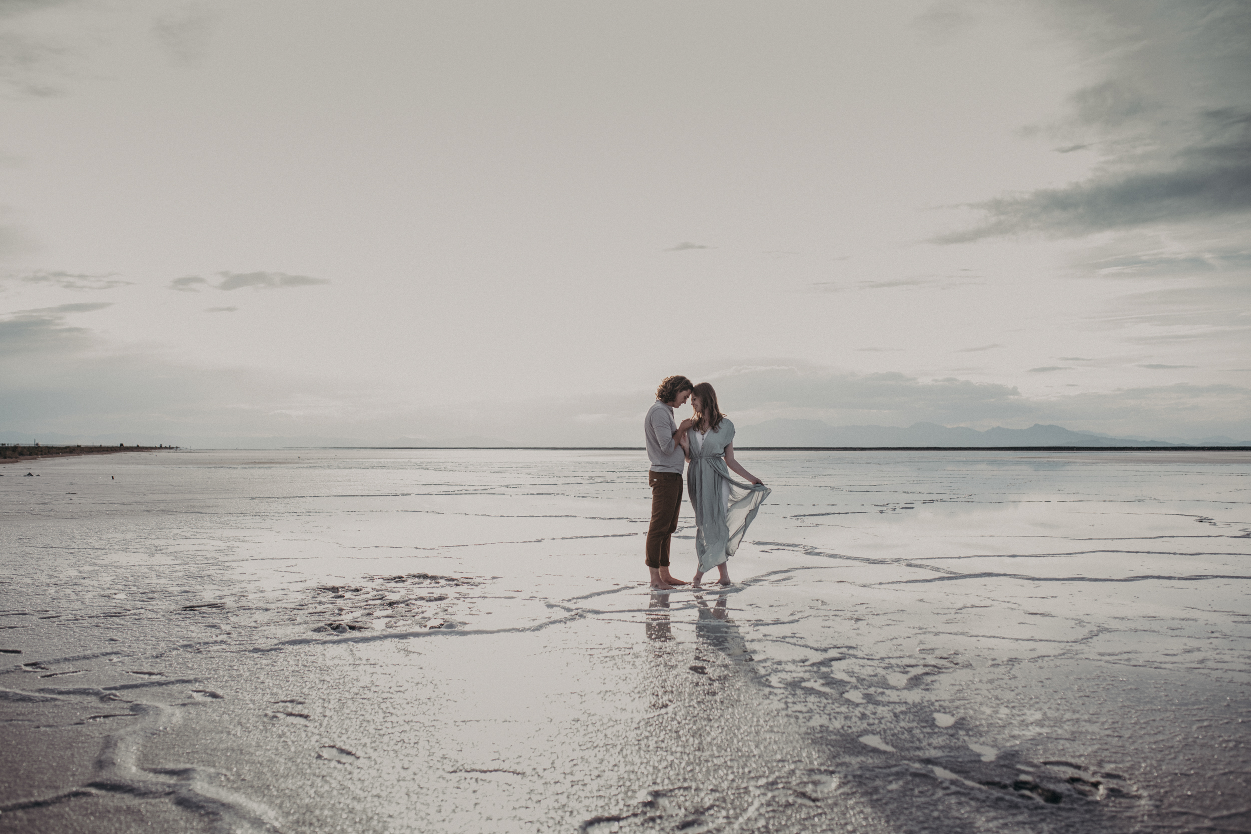 Couple holding hands on the salt flats