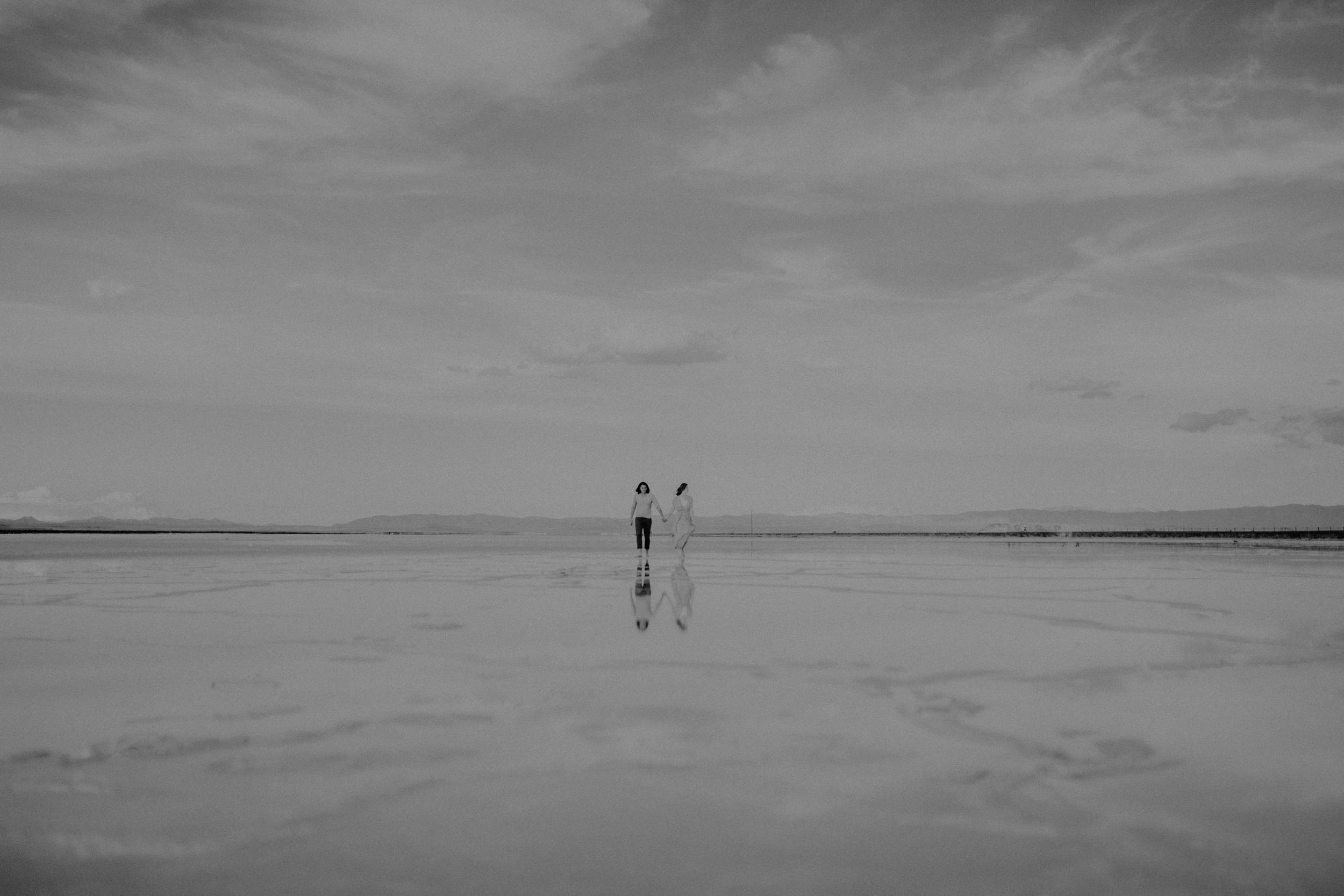 Couple  hand in hand on the salt flats