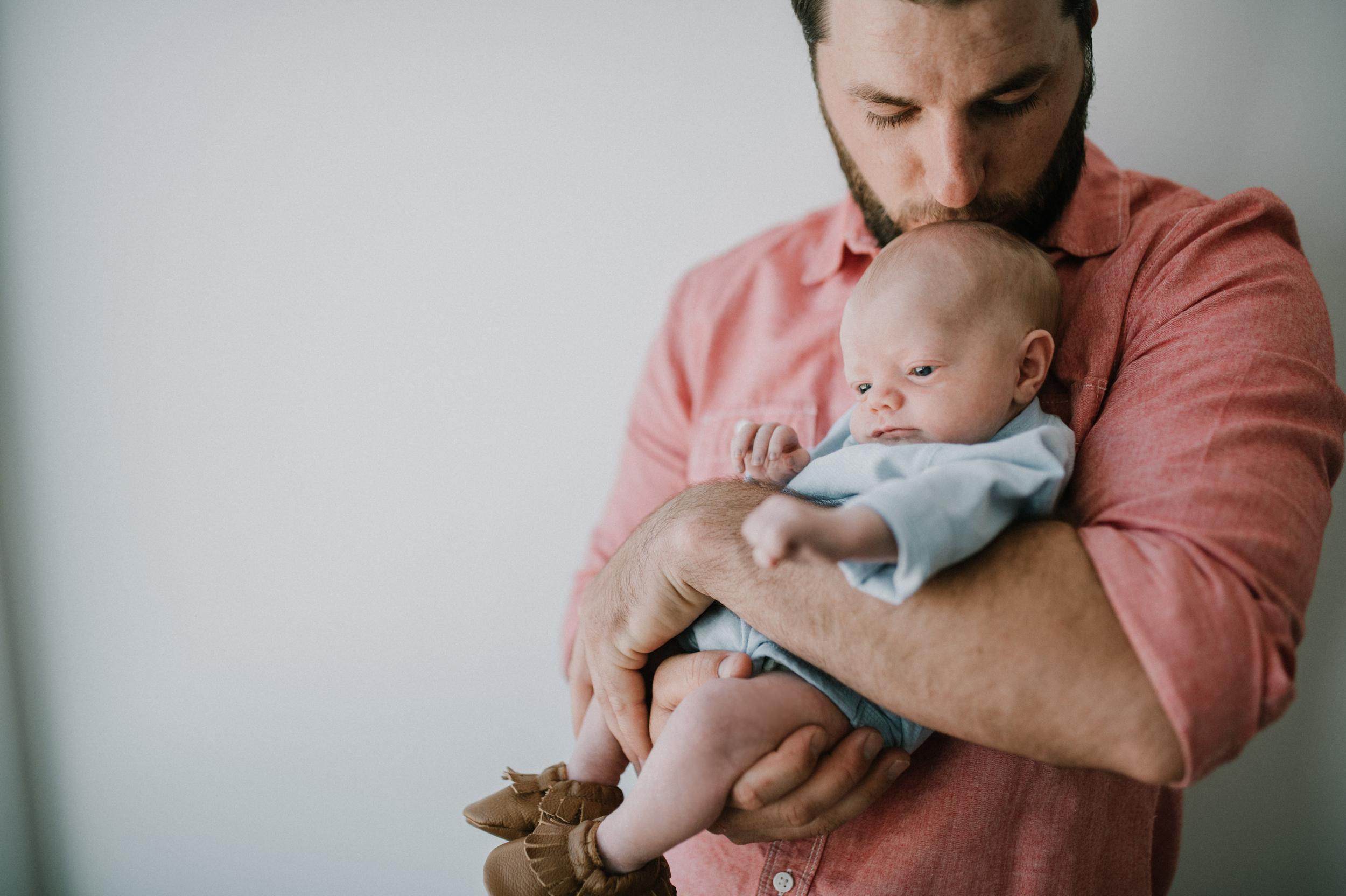 Dad kissing baby boy