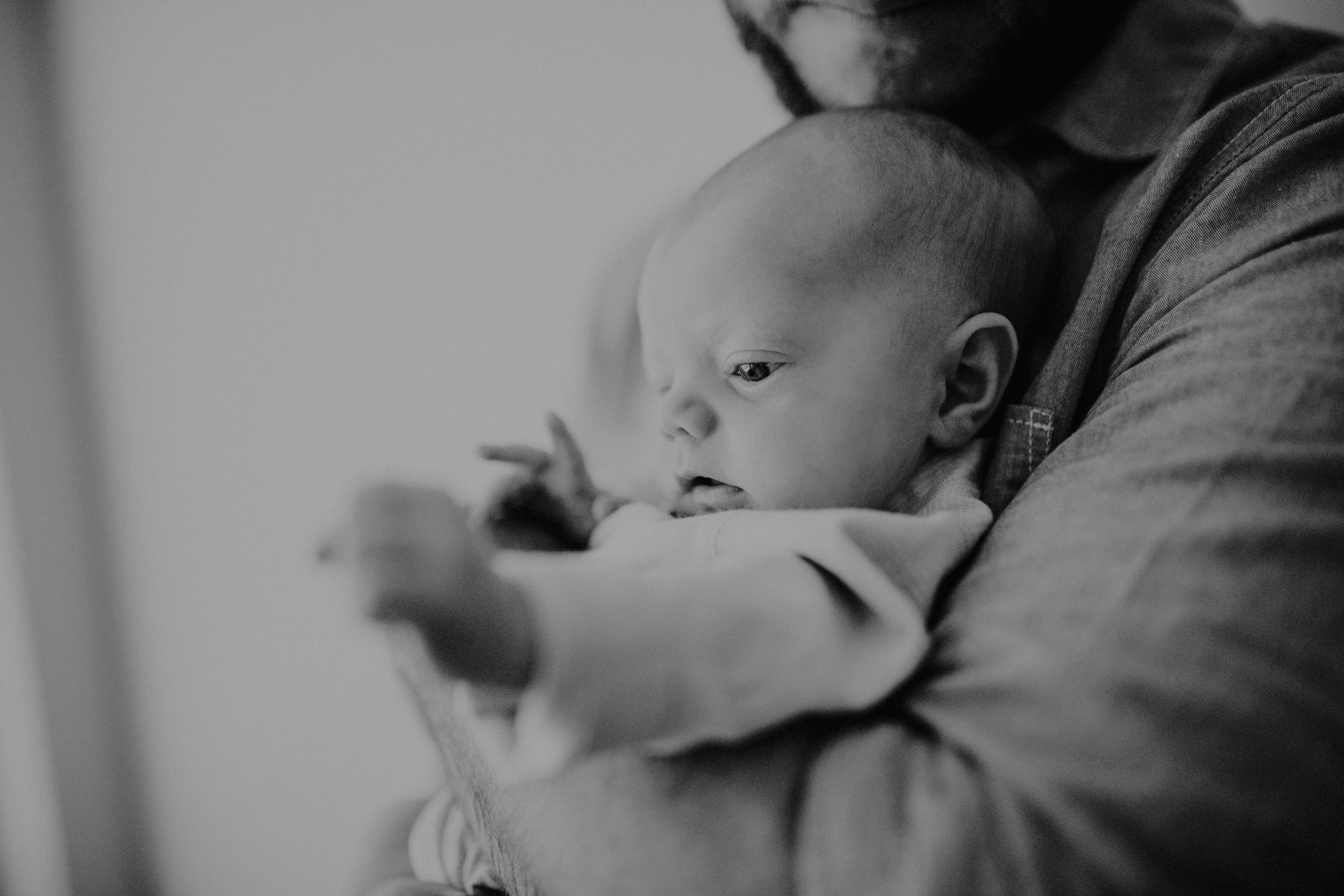 Dad holding baby boy
