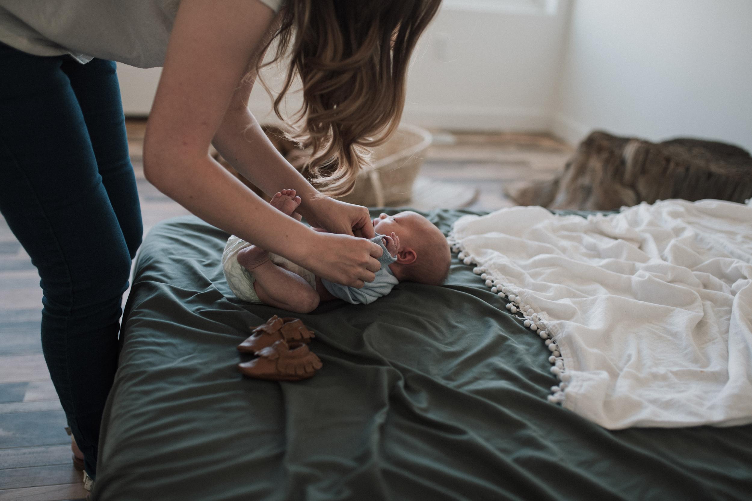 Mom dressing baby boy