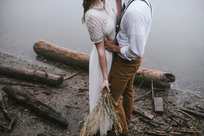 Lakeside elopement of bridal couple with sagebrush bouquet
