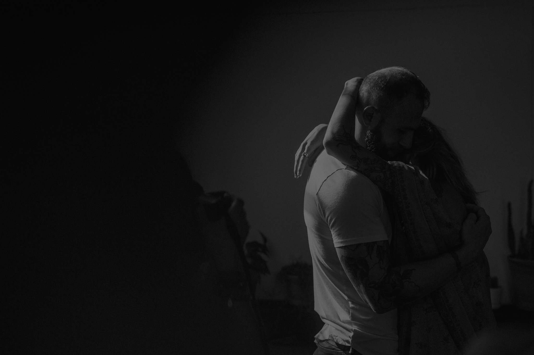 Moody black and white of couple hugging