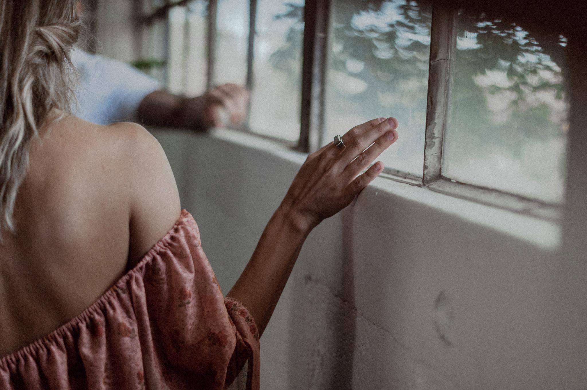 Girls hand running along window