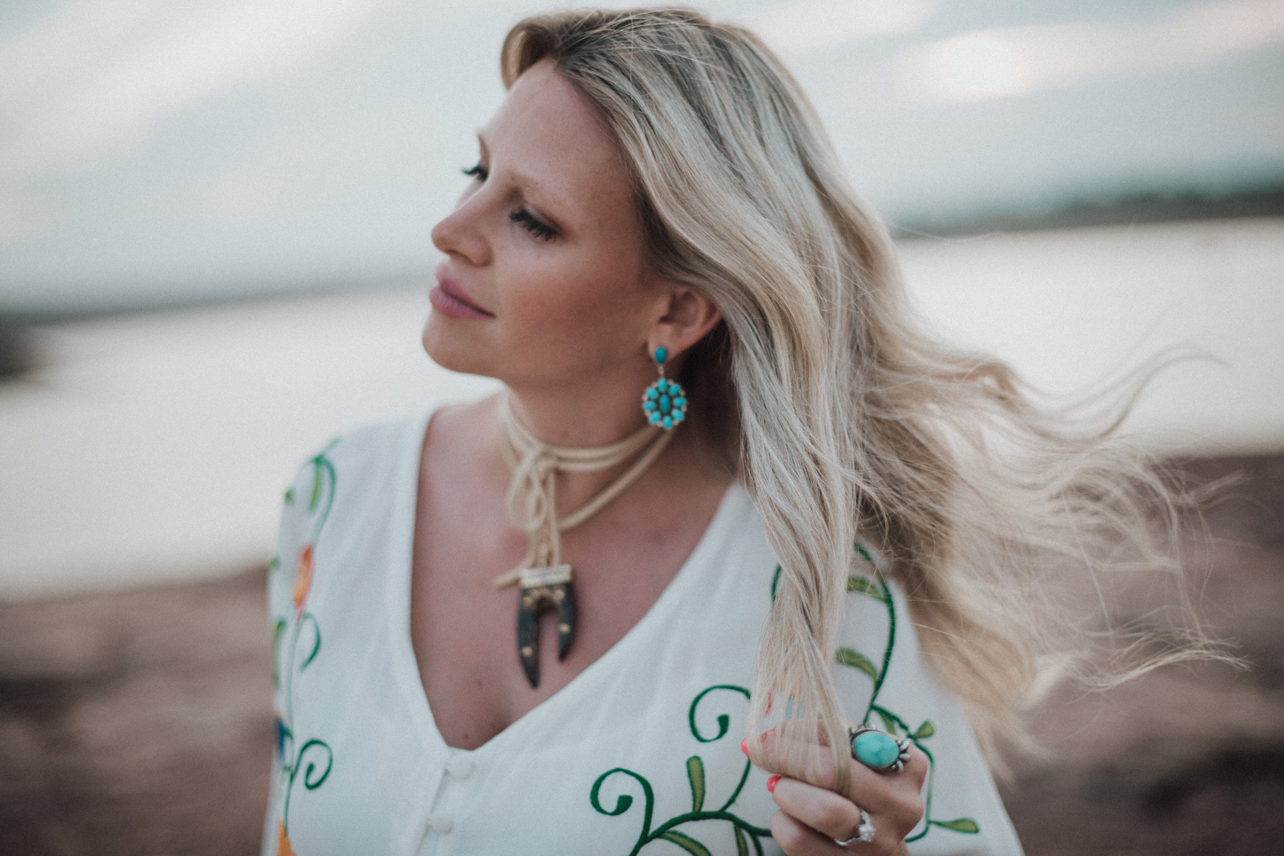 turquoise tribal jewelry blonde hair blowing in the wind