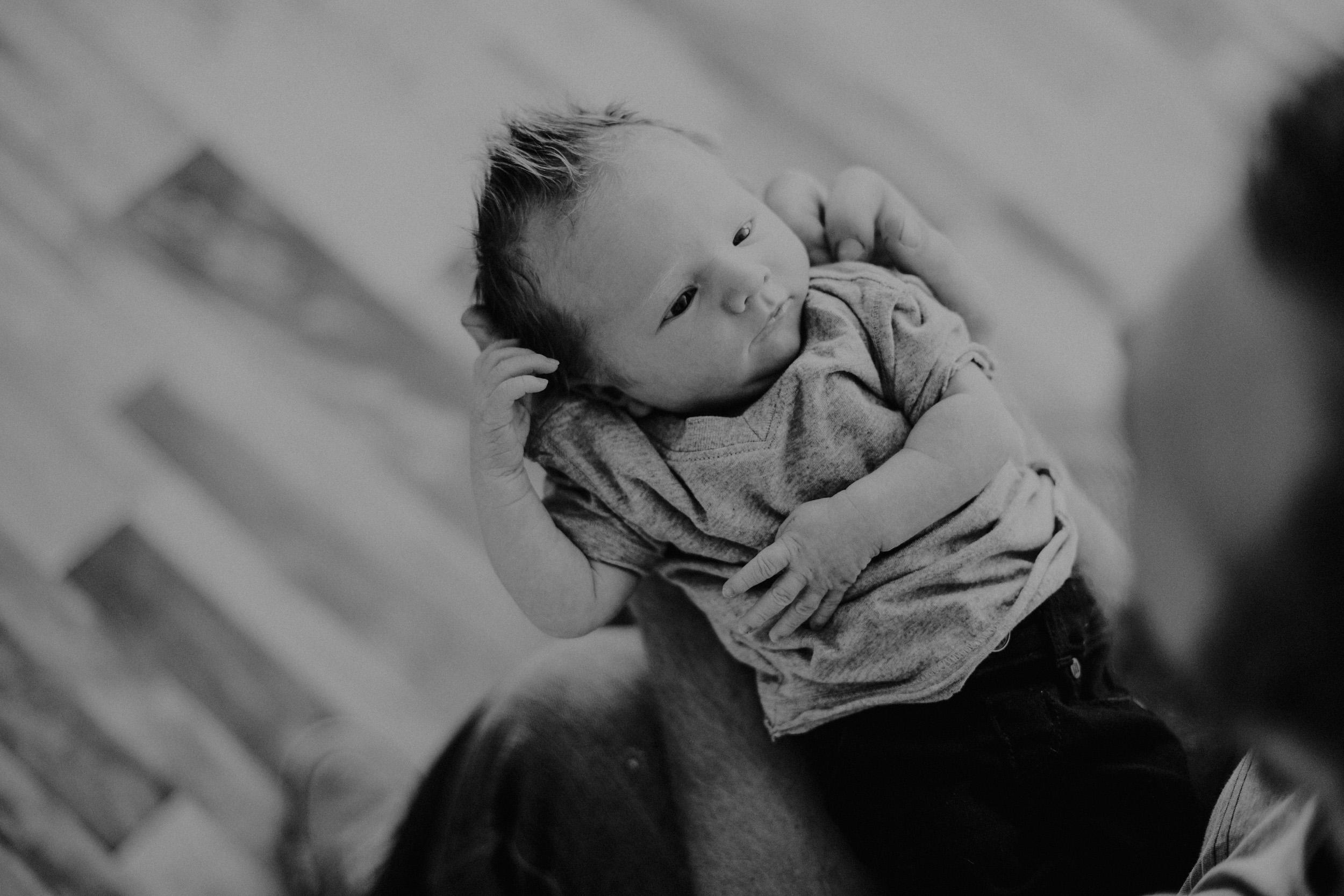 newborn baby boy being held by dad