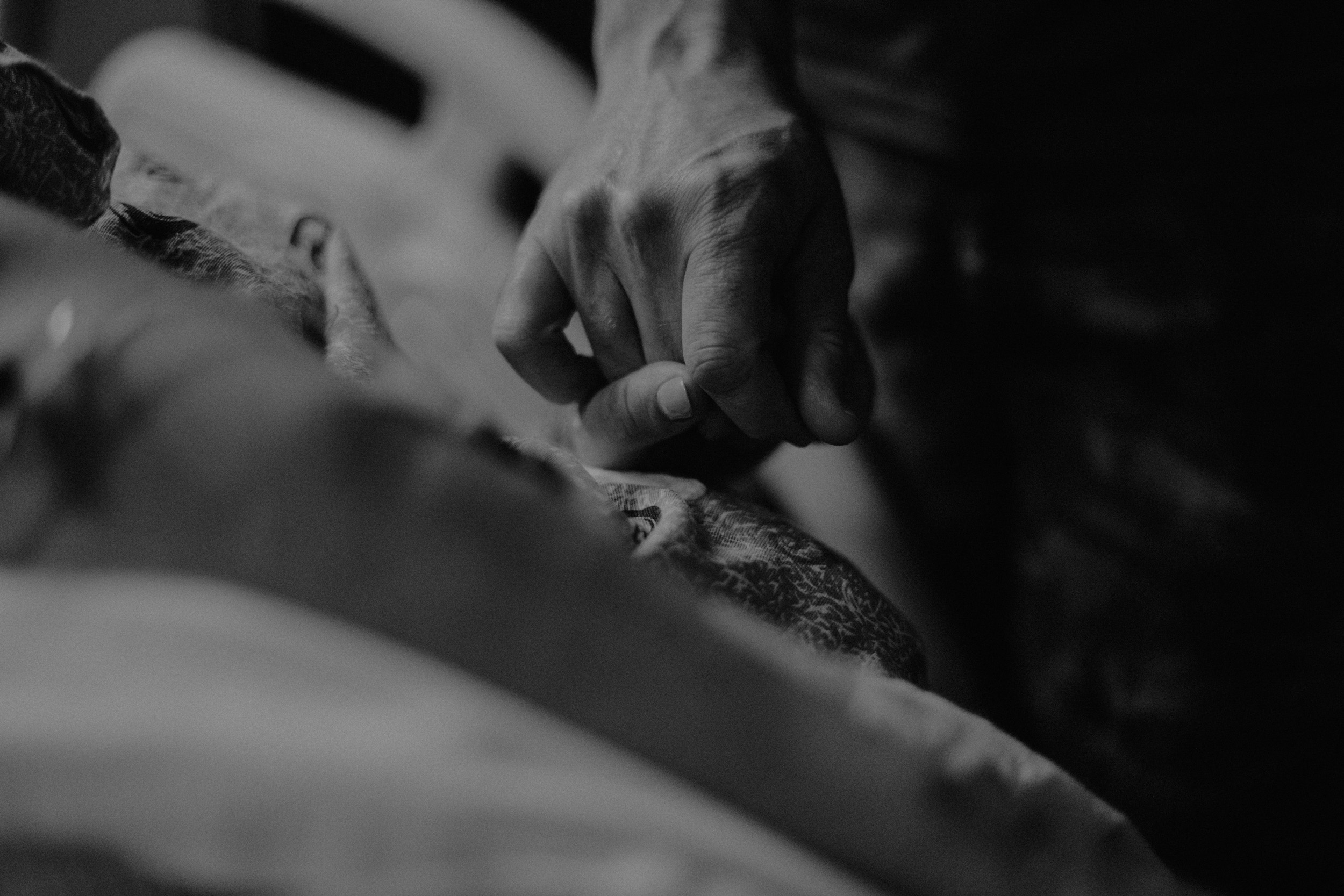 dad holding mom's hand in labor in labor and delivery