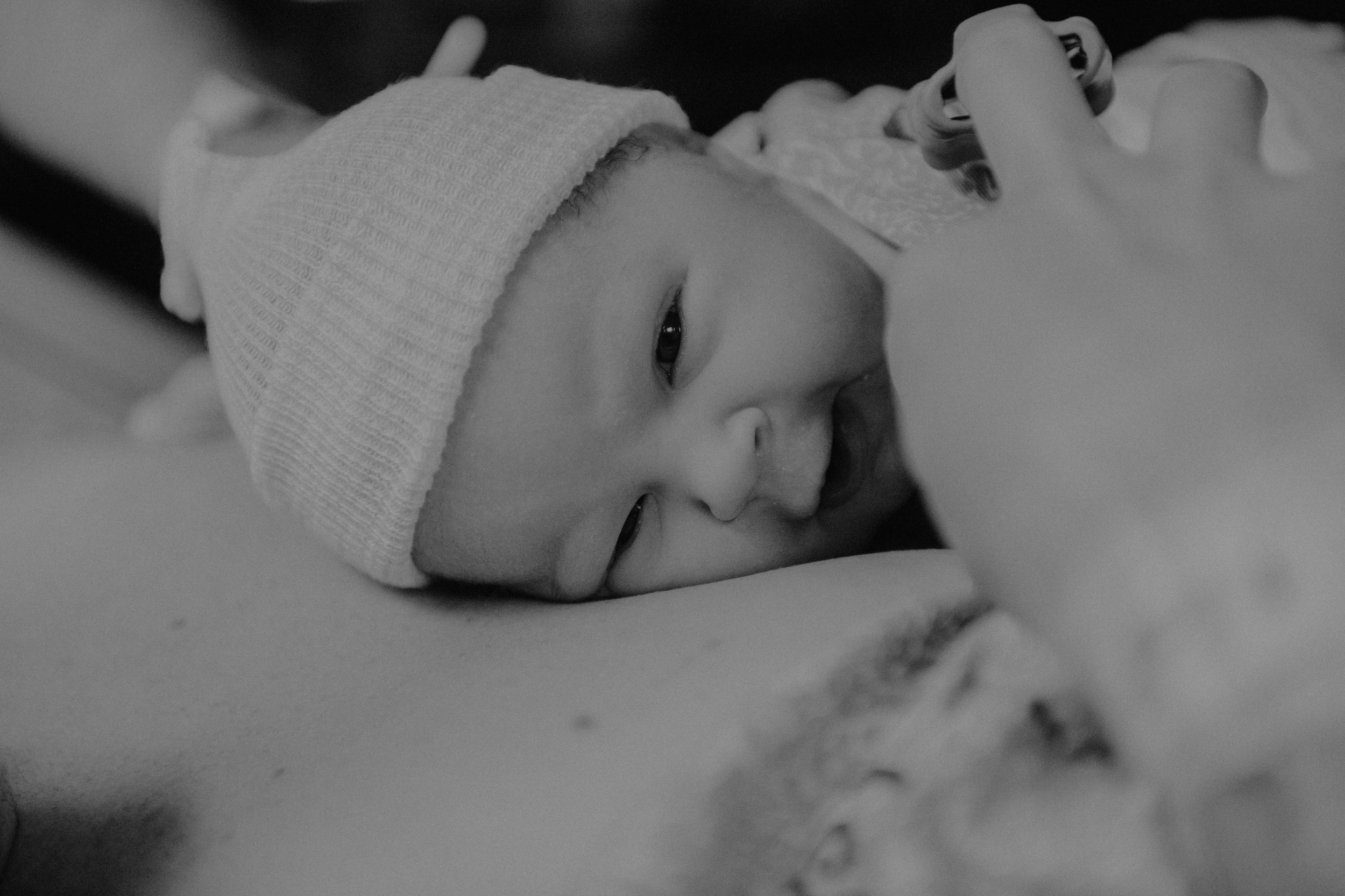 baby lying skin to skin on mom's chest after delivery